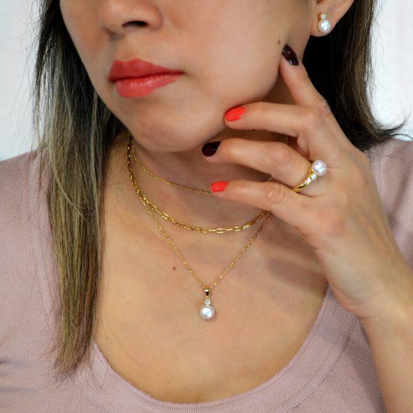Conjunto de plata con perla bañado en oro
